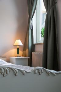 A bed or beds in a room at Hotell Leksand