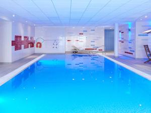 The swimming pool at or near Novotel Milton Keynes