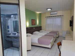 A bed or beds in a room at Hotel Recanto Wirapuru