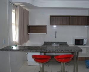 A kitchen or kitchenette at Apartamento Flat Lacqua DiRoma
