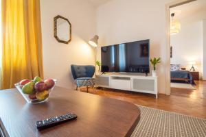 Telewizja i/lub zestaw kina domowego w obiekcie Trip Apartments