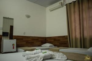 A bed or beds in a room at Bento palace hotel