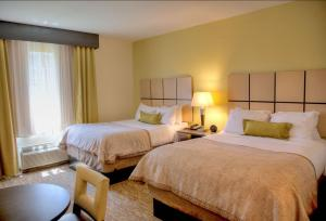 A bed or beds in a room at Candlewood Suites Alexandria
