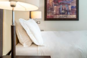 Кровать или кровати в номере Europalace Hotel
