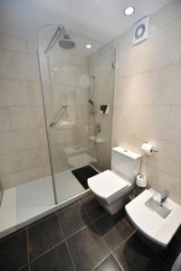 Een badkamer bij Hotel Vallemar