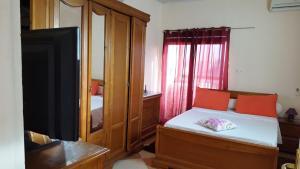 A bed or beds in a room at niveau de villa kouba