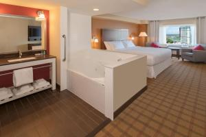 A bed or beds in a room at Four Points by Sheraton Niagara Falls Fallsview