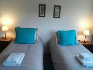 Una cama o camas en una habitación de Los Coirones Aparts - El Chaltén - Patagonia