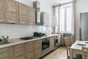 Kuchyň nebo kuchyňský kout v ubytování Apartament Poznańska