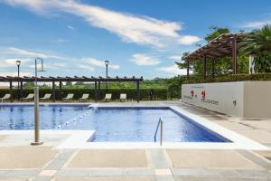 The swimming pool at or near DoubleTree by Hilton Managua