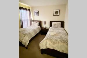 A bed or beds in a room at Spacious 6 Bed with Pool