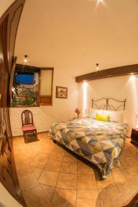 Cama o camas de una habitación en Hotel Mesón de los Remedios