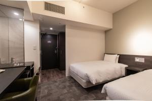 A bed or beds in a room at Hotel Vista Ebina
