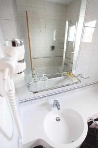 Koupelna v ubytování Dorijini Dvori