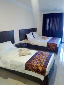 A bed or beds in a room at mass paradise2