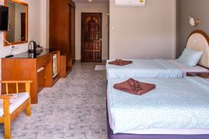 A bed or beds in a room at Pineapple Guesthouse