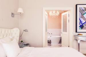 Кровать или кровати в номере Hotel Sans Souci Wien