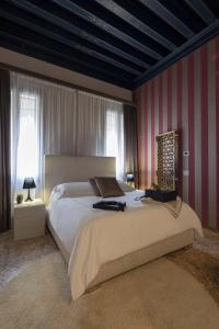 A bed or beds in a room at Corte Di Gabriela