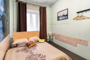 Кровать или кровати в номере Мини-отель На Берегах Невы