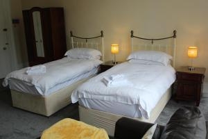 A bed or beds in a room at The Darnley Hotel