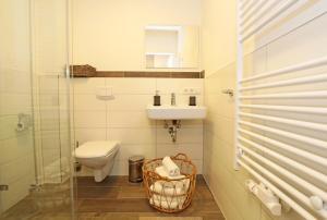 Ein Badezimmer in der Unterkunft Aparthotel St. Marien Altstadt