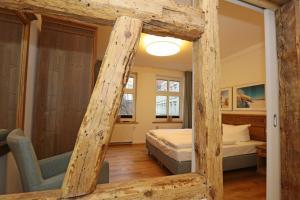 Ein Etagenbett oder Etagenbetten in einem Zimmer der Unterkunft Aparthotel St. Marien Altstadt