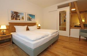 Ein Bett oder Betten in einem Zimmer der Unterkunft Aparthotel St. Marien Altstadt