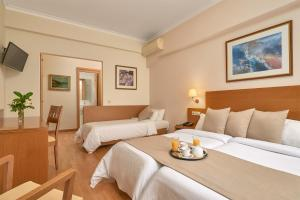 A bed or beds in a room at Athos Hotel