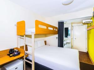 A bunk bed or bunk beds in a room at ibis Budget Sydney Olympic Park