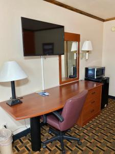 A television and/or entertainment center at Green Tree Inn
