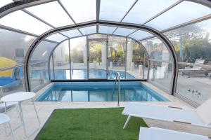 The swimming pool at or near Romantic suite in Caesarea