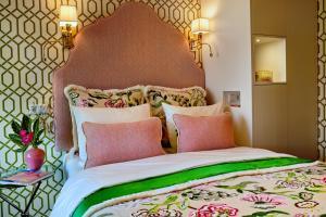 Un ou plusieurs lits dans un hébergement de l'établissement Hotel Estheréa