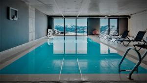 The swimming pool at or near Quadrum Hotel