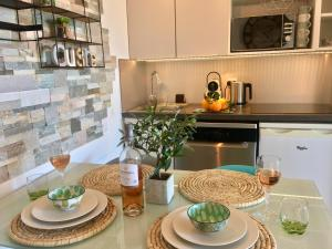 A kitchen or kitchenette at MyHome Riviera - Cannes Sea View Apartment Rentals