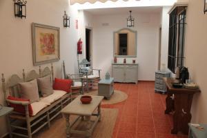 Uma área de estar em Apartamentos Peregrinos