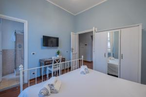 A bed or beds in a room at Myrtus Guest House