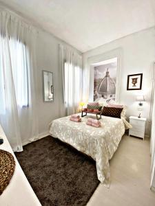 Cama o camas de una habitación en Santo Spirito Suite