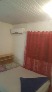 A bed or beds in a room at Pousada galaxi