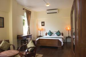 A bed or beds in a room at La Villa