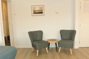 Ein Sitzbereich in der Unterkunft Bed&Breakfast aan Strand
