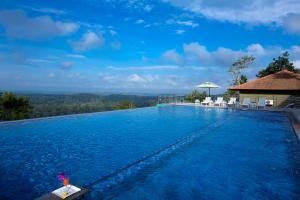 The swimming pool at or close to Coorg Cliffs Resorts