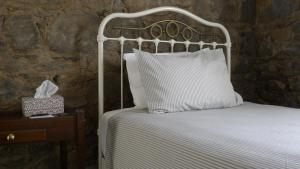 A bed or beds in a room at Elephant Bridge Hotel