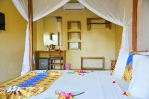 A bed or beds in a room at Filao Beach Zanzibar