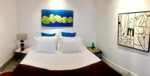 Cama ou camas em um quarto em Gloc Villa
