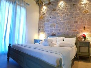 Ένα ή περισσότερα κρεβάτια σε δωμάτιο στο Αμυγδαλιές