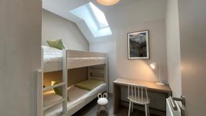 A bunk bed or bunk beds in a room at Le Génépy - Appart'hôtel de Charme