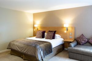 A bed or beds in a room at Barton Manor Hotel & Spa; BW Signature Collection