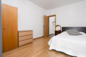 A bed or beds in a room at Casa Gago