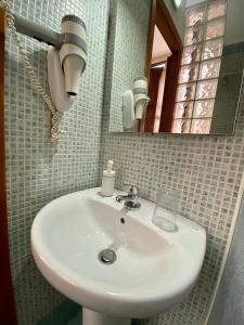 Ванная комната в Hotel Resi