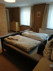 A bed or beds in a room at Neues Vaterland